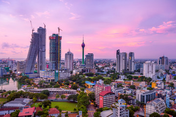 Foto auf Leinwand New York Colombo Sri Lanka skyline cityscape photo. Sunset in Colombo with views over the biggest city in Sri Lanka island. Urban views of buildings and the Laccadive Sea