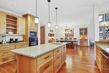 Beautiful kitchen with light wood cabinets