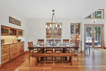 White spacious dining area with built in cabinets
