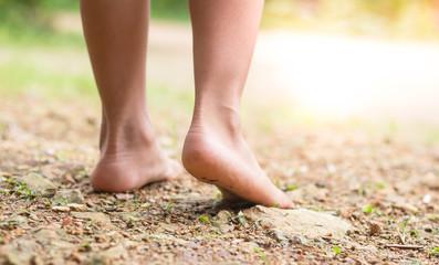 Legs walking alone at park.