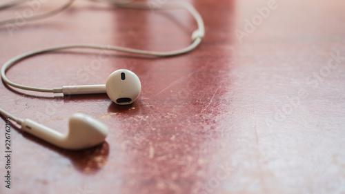 Wall mural earphone white on wood table