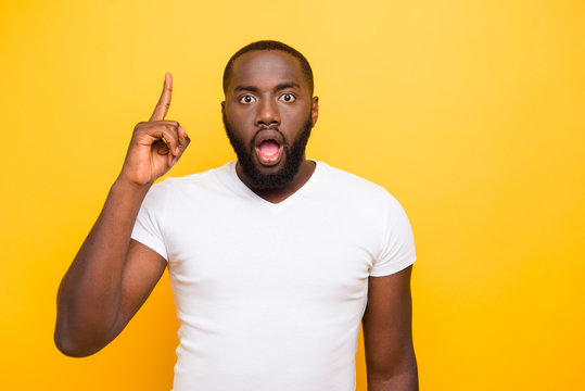 Handsome attractive shocked manly mulato guy in white t-shirt, p