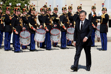 Uzbekistan's President Shavkat Mirziyoyev arrives for a meeting with French President Emmanuel Macron at the Elysee Palace in Paris