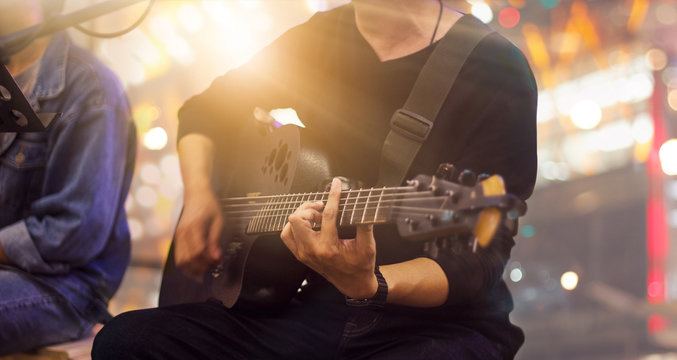 Guitarist on stage and singer in a concert for background, soft and blur concept.