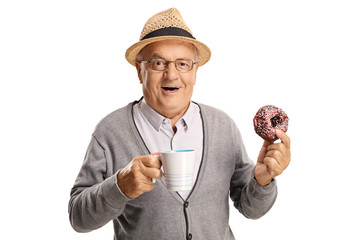 Mature man holding a cup and a donut