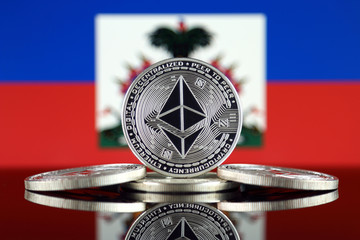 Physical version of Ethereum (ETH) and Haiti Flag. Conceptual image for investors in cryptocurrency, Blockchain Technology, Smart Contracts, Personal Tokens and Initial Coin Offering.