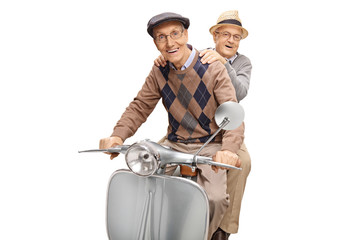 Two senior men riding on a scooter