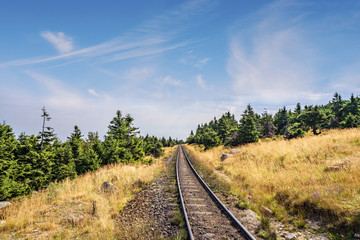 Prairie landscape with a railroad under a blue sky