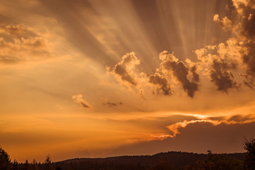 Sunset with rays lighten up the clouds