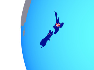 New Zealand with embedded national flag on blue political globe.