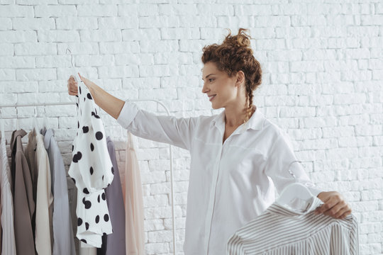 A Woman Choosing Clothes