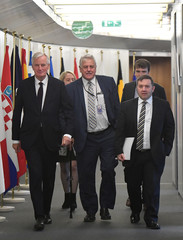 EU's chief Brexit negotiator Barnier walks with UUP leader Swann and UUP member Nicholson in Brussels