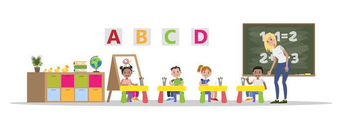 Preschool kids study in classroom with teacher