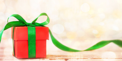 Banner Christmas gift box with green ribbon and copy space.