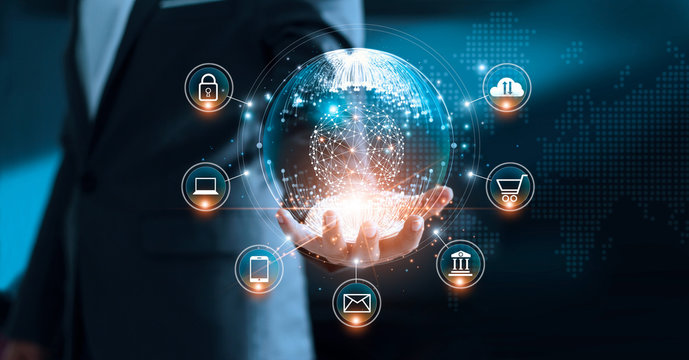 Digital marketing. Businessman holding global circle modern interface payments online shopping and icon customer network connection on virtual screen. Data exchanges worldwide.
