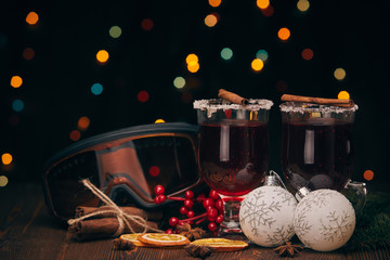 Glasses of mulled wine on wooden table