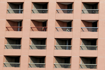 Egyptian workers paint balconies of Hilton hotel rooms in Cairo