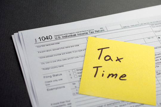 Time for Taxes Money Financial Accounting Concept. U.S. Individual income tax return 1040 tax form