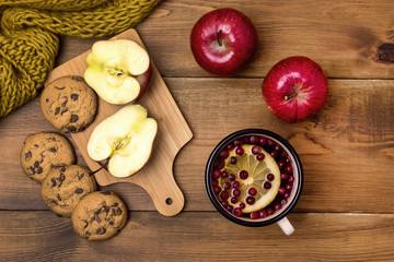 Top View of Cozy Autumn Morning at Home Breakfast With Cup of Hot Berries Tea Red Apples Cookies Yellow Woolen Scarf Wooden Background Flat Lay
