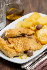 cod fish with fried potato on white dish