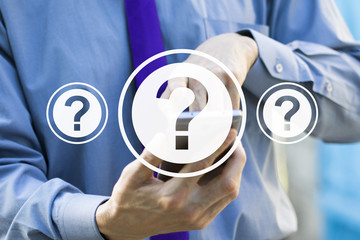 Wall Mural - Businessman pressing on modern technology panel question icon