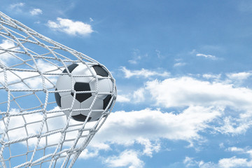 Fototapeta 3d rendering of a football ball unable to tear the net from the gates with cloudy sky in the background.