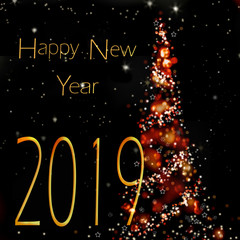 2019 happy new year writting on abstract night next to a christmas tree