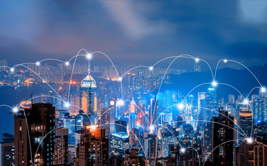 Digital network connection lines of Hong Kong Downtown and Victoria Harbour. Financial district in smart city in technology concept. Skyscraper and high-rise buildings. Aerial view at night. Fotomurales