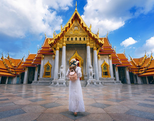 Wall Mural - Women tourists at Wat Benchamabophit or the Marble Temple in Bangkok, Thailand.