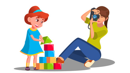 Mother Taking Pictures Of Her Child Playing With Toys Vector. Isolated Illustration