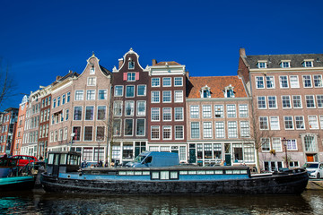 Canals, boats and beautiful architecture at the Old Central district in Amsterdam