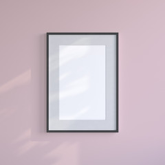 Black blank frame on the pink wall. Frame mock up.