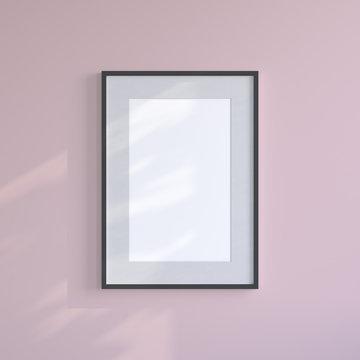 Black blank frame on the pink wall. Frame mock up.