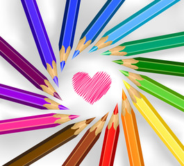 Colored pencils in a circle with heart