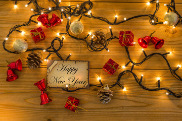 Greeting card for new year or christmas with christmas decors, lights top view