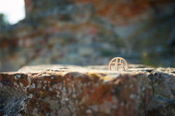 Bit Coin on old brick wall