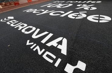 """The logo Eurovia Vinci is seen at a mobile factory installed to produce tons of recycled asphalt near the A10 motorway in Gironde for a test for the first """"100% recycled"""" road by Eurovia"""
