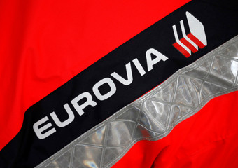 """The Eurovia logo is seen on a jacket during a visit at a mobile factory installed to produce tons of recycled asphalt near the A10 motorway in Gironde for a test for the first """"100% recycled"""" road by Eurovia"""