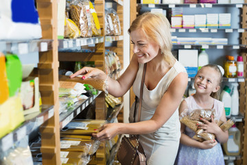 Portrait of  woman and girl gladly  shopping of pasta