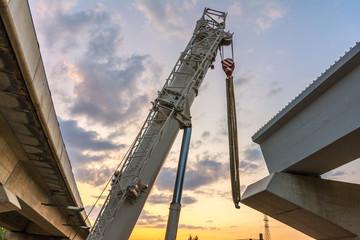 Construction of a bridge with a crane truck