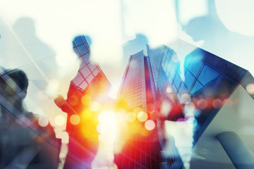 Silhouette of business people work together in office. Concept of teamwork and partnership. double exposure with network effects
