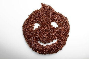 Coffee beans in the shape of a smiley face