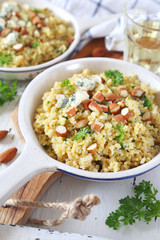 Bulgur cereal risotto with blue cheese, parsley and almonds, two servings