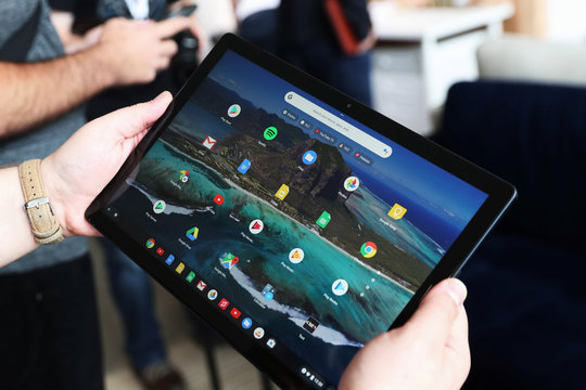 The Google Pixel Slate is held after a news conference in Manhattan, New York