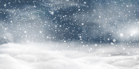 Natural Winter Christmas background with storm clouds, sky, heavy snowfall, snowflakes in different shapes, snowdrifts. Winter landscape with falling christmas shining beautiful snow.