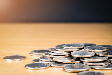 US QUARTER COINS ON WOODEN TABLE WITH BLACK BACKGROUND Fototapete