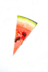 A piece of watermelon cut by a triangle. White background