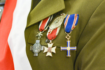 Military decorations on the uniform of the Polish army with the flag on the chest.