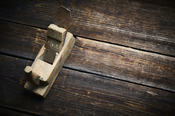 Carpenter tabletop with old hand plane. Traditional woodworking.