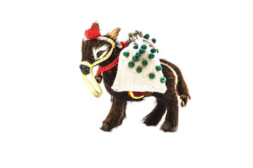 Miniature toy of wool in the form of a donkey with a bag